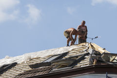 Construction Workers on Roof of Building Royalty Free Stock Images