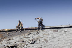 Construction Workers Roofing A Barn Stock Photography