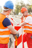Construction workers in safety uniform. Picture of construction workers in orange safety uniform Stock Photo