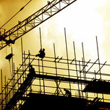 Construction workers on scaffolding Stock Images