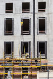 Construction workers on scaffolding - building facade constructi Stock Photos