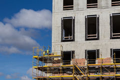 Construction workers on scaffolding - building facade constructi Stock Photography