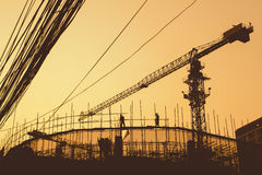 Construction workers and scaffolding. At sunset Royalty Free Stock Images