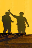 Construction workers shadows Royalty Free Stock Photos