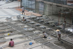 Are construction workers in SHENZHEN Baoli Culture Square Royalty Free Stock Photo