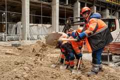 Construction workers with a shovel Royalty Free Stock Image