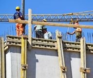 Construction workers at the construction site. Outdoor stock photography