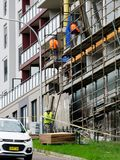 Construction Workers on site at 47 Beane St. Gosford. March, 2019. Building update ed222. Gosford, New South Wales, Australia - March 18, 2019: Workmen close up royalty free stock photo