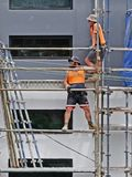 Construction Workers on site at 47 Beane St. Gosford. March, 2019. Building update 210. Gosford, New South Wales, Australia - March 6, 2019: Workmen close up royalty free stock photo
