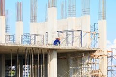 Construction workers site and building of housing at laborer work outdoor. which has sky background with copy space add text.  Stock Photos