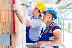 Construction workers on site checking quality Stock Images
