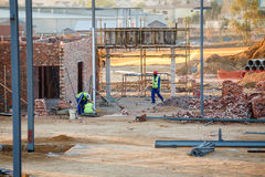 Construction workers. On a site dressed in protective wear in Johannesburg South Africa royalty free stock image