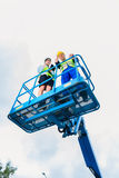 Construction workers on site in hydraulic lifting ramp Royalty Free Stock Photography