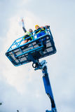 Construction workers on site in hydraulic lifting ramp Stock Photography