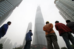Construction workers in smoggy Shanghai Stock Photo