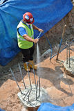 Construction workers spraying the anti termite chemical treatment Stock Photo