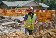 Construction workers spraying the anti termite chemical treatment Royalty Free Stock Images