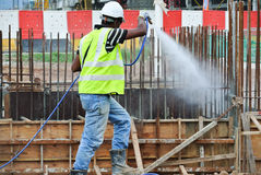 Construction workers spraying the anti termite chemical treatment Royalty Free Stock Photos