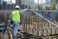Construction workers spraying the anti termite chemical treatment Royalty Free Stock Image