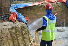 Construction workers spraying the anti termite chemical treatment to the pile cap Royalty Free Stock Image