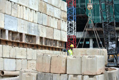 Construction workers stacking the maintain load test block at the construction site Royalty Free Stock Photo