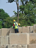 Construction workers stacking the maintain load test block at the construction site Royalty Free Stock Images