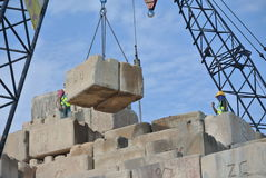 Construction workers stacking the maintain load test block at the construction site Stock Image