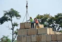 Construction workers stacking the maintain load test block at the construction site Stock Photo