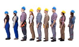 Construction workers standing in queue. Isolated on white stock photography