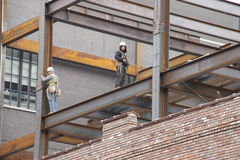 Construction workers on steel beams in in new york city Royalty Free Stock Photos
