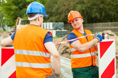 Construction workers talking. Image of two construction workers talking on construction site stock image