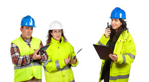 Construction workers talking with a walkie talkie Stock Images