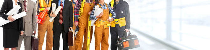 Construction workers team. Group of professional construction workers contractor on abstract background stock photos