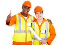 Construction workers thumb up. Happy construction workers giving thumb up Royalty Free Stock Image