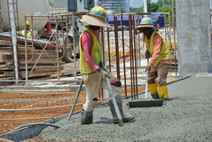 Construction Workers Using Concrete Vibrator Royalty Free Stock Photos
