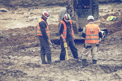 Construction workers using magnetic locator 2 Stock Photography