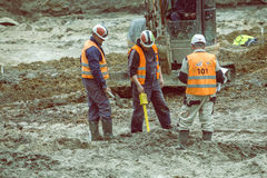 Construction workers using magnetic locator 3 Royalty Free Stock Images