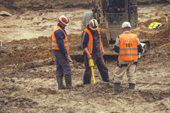 Construction workers using magnetic locator Royalty Free Stock Photo