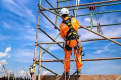 Safety harness. Construction workers wearing safety harness belt during training at high place Royalty Free Stock Photos