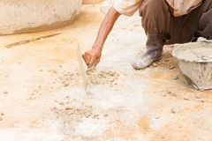 Construction workers were plastering repair floor in workplace build a house. With copy space add text royalty free stock images