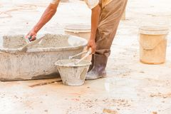 Construction workers were plastering repair floor in workplace build a house. With copy space add text royalty free stock photo