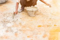 Construction workers were plastering repair floor in workplace build a house. With copy space add text stock images