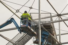 Construction workers at work on a bridge stock image