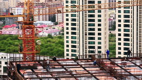 Construction workers at work stock footage
