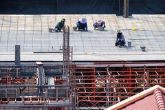 Construction workers are working on building. Stock Photos