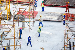Construction workers. Working on a building site with hard hats and protective wear in the Sandton CBD in Johannesburg, South Africa stock photography
