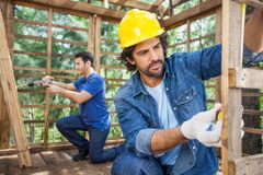 Construction Workers Working At Construction Site Royalty Free Stock Images