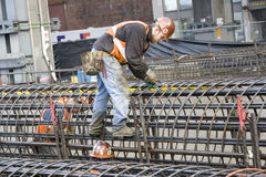 Construction workers working hard Royalty Free Stock Photos