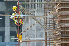 Construction workers working at high level royalty free stock photo