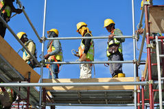 Construction workers working at high level Stock Photo
